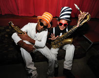 Funky musicians with saxophone royalty free stock image