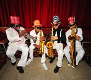 Funky musicians, wind instruments. Portrait of four funky musicians playind wind instruments, saxo, trumpet Royalty Free Stock Photography