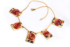 Funky necklace. Red and gold funky hand made necklace stock images