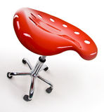 Funky office stool. A closeup, fish eye view of an unusual, funky office chair or stool on wheels, isolated on white royalty free stock image
