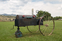 Funky Old Tractor in Masonville, CO. This funky old tractor sits in a field with other Old West Nostalgia objects in Masonville, CO Royalty Free Stock Photography
