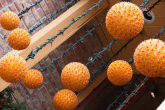 Funky Orange hanging light fixtures Stock Image