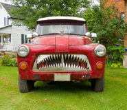 a funky pick-up truck parked in the countryside Stock Photo