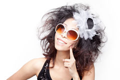 Funky, quirky, eccentric young chinese woman. Eccentric young chinese girl with toothy, wide smile. Retro look with funky, quirky sunglasses and hair accessories Royalty Free Stock Images