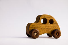 A funky retro wooden toy car. Made of wood isolated on a white background Stock Photography