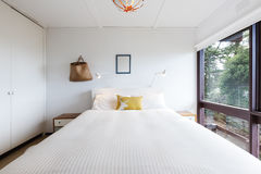 Funky 70s retro bedroom in a beach house. Funky 70s retro bedroom in an old beach house stock photos