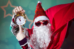Funky Santa Claus with alarm clock wearing heart Stock Images