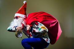 Funky Santa Claus with alarm clock wearing heart Royalty Free Stock Photo