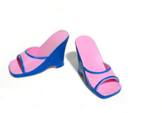 Funky shoes. Hot pink and blue shoes royalty free stock photography