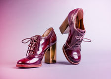 Funky shoes. Designer shoes shot on a light pink background Royalty Free Stock Photo
