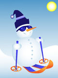 Funky snowman skiing. A skiing Snowman wearing sunglasses Royalty Free Stock Photos