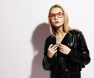 Funky style beauty. Beautiful young blond woman wearing glasses stock photos