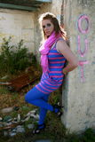 Funky teen. A beautiful white caucasian girl teenager dressed in funky, bright clothing stock image