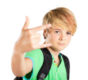 Funky teen boy. Giving hand sign royalty free stock images