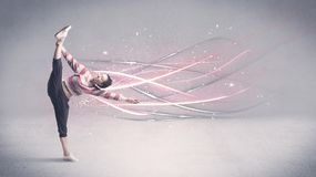Funky urban dancer with glowing lines. A pretty hip hop dancer dancing contemporary dance illustrated with glowing motion lines in the background concept Stock Photo
