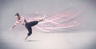 Funky urban dancer with glowing lines. A pretty hip hop dancer dancing contemporary dance illustrated with glowing motion lines in the background concept Stock Photography