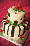 Funky wedding cake. Over red pattern background royalty free stock photo