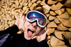 Funky winter sports. Man screaming in ski mask Royalty Free Stock Photography