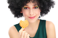 Funky woman eating cookie Royalty Free Stock Images