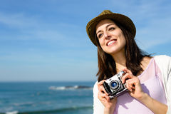 Funky woman taking photo on coast travel Royalty Free Stock Photography