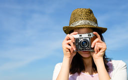 Funky woman taking photo on sky background Stock Photo