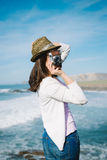 Funky woman taking photo on travel Stock Images