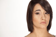 Funky young woman. Young attractive woman with short hairstyle looking straight into camera on white background Stock Photo