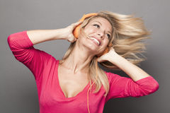 Funky young woman thrilled at good vibes with headphones on Stock Image