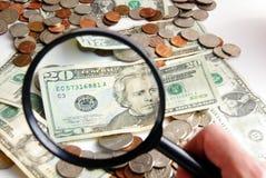 funna pengar Arkivbild