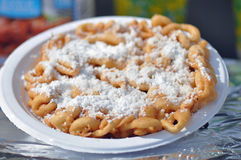Funnel Cake Elephant Ear. Fried dough funnel cake or elephant ear sold at the North Carolina State Fair Grounds in Raleigh stock photos