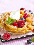 Funnel cakes with fresh berries and whipped cream Stock Images