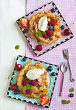 Funnel cakes with fresh berries and whipped cream Royalty Free Stock Photos