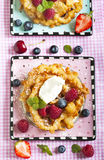 Funnel cakes with fresh berries and whipped cream Royalty Free Stock Images