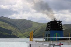Funnel of ferry with South Island New Zealand in distance Stock Photos