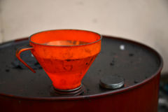 Funnel in oil drum Royalty Free Stock Photography