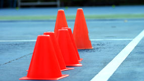 Funnel. Orange funnel is on the floor of tennis course. Portrail and view landscape royalty free stock photo