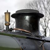 Funnel and whistle of a steam locomotive (detail). The funnel and whistle atop the boiler of a steam locomotive. Locomotive is British Railways Standard class Royalty Free Stock Images