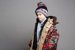 Funnu Boy in winter outerwear. kid wore all his clothes stock image