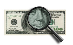 funny $100 banknote through the magnifier stock photo