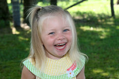That is so Funny!. A young girl laughs at a funny moment Royalty Free Stock Images