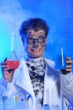 Funny. Medical theme: funny crazy scientist is working in a laboratory Royalty Free Stock Photography
