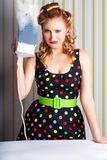 Funny 50s Pinup Girl Holding Steaming Hot Iron Royalty Free Stock Photo