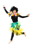 Funny aborigine woman in native costume dancing isolated Stock Image