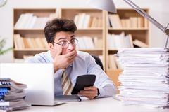 The funny accountant bookkeeper working in the office. Funny accountant bookkeeper working in the office Royalty Free Stock Photos