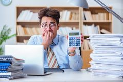 The funny accountant bookkeeper working in the office stock image