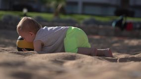 Funny action - little boy 1 year falling with volleyball ball. The action in the real time stock video footage