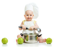 Funny adorable baby with green apples Stock Photos
