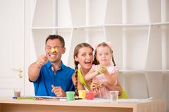 Funny adorable family paining Stock Images