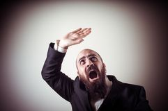 Funny afraid elegant bearded man Stock Photography