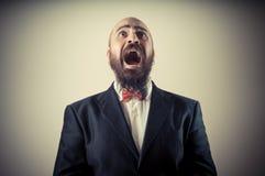 Funny afraid elegant bearded man Stock Photos